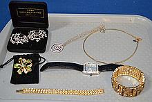 NOLAN MILLER JEWELRY LOT 6 PIECES. Lot includes: (10 NOlan Miller rhinestone necklace, three graduated circle pendant with silver chain. 16'' chain, 1 1/2''Diam. pendant. (1) Nolan Miller clear and green rhinestone bow brooch. 2''diam. (1) Nolan