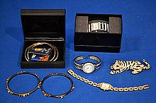 RHINESTONE JEWELRY LOT 8 PIECES. Lot includes; (1) rhinestone bracelet. (2) Sonia Britton for Brilliante CZ encrusted bangle bracelet. (1) Rhinestone decorated watch with quartz movement. Marked: China. (1) gossip cuff bracelet watch with