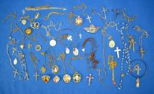 ASSORTED RELIGIOUS JEWELRY - includes crucifix, medals, pendants, crosses and more - Condition: Age appropriate wear; All items sold as is.