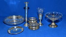(9) VARIOUS STERLING AND SILVER PLATE ITEMS - including Reed & Barton candle holder, coasters, compote and others - Condition: Age appropriate wear; All items sold as is.