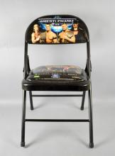 WWE WRESTLEMANIA 23 FOLDING CHAIR - Sunday April 1, 2007, Featuring Donald Trump, Vince McMahon, Stone Cold Steve Austin, Bobby Lashley and Umaga on the seat; Chair back features Shawn Michaels, John Cena, Batista and The Undertaker; Measures 39''H x 15.5''W x 15.5''D (with seat out) - Condition: Age appropriate wear; All items sold as is.