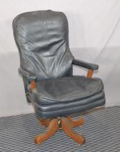 EXECUTIVE OFFICE CHAIR - Blue leather office chair with open arms and swivel rocking base - Condition: Age appropriate Wear; All items sold as is.