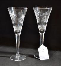 (2) WATERFORD CRYSTAL 9.25''H CHAMPAGNE GLASSES - mark etched in base; 4'' hexagon base - Condition: Both have chips on base; Age appropriate wear; All items sold as is.