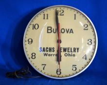 VINTAGE BULOVA ELECTRIC ADVERTISING WALL CLOCK 1930/40'S - Jewelry Ship curved glass cover; Working condition, lights up; 15'' diameter - Condition: Age appropriate wear; All items sold as is.