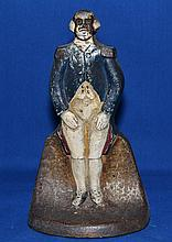 GEORGE WASHINGTON DOORSTOP    Polychromed cast metal doorstop in the form of a standing George Washington.  8 1/2'' hieght.  No Mark. Condition age appropriate wear.  Surface wear.