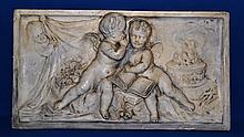 PLASTER PLAQUE   Neoclassical style plaster plaque.  Horizontal format with three putti and book. 11'' hieght.  20'' wide.  No Mark. Condition age appropriate wear. Top left corner has been repaired.
