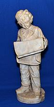 ALABASTER SCULPTURE  BOY READING NEWSPAPER   Figure of boy wearing derby hat and reading a newspaper.  14'' hieght.  No Mark.  Condition age appropriate wear.  Base has been repaired.