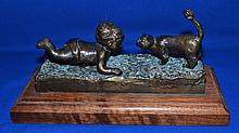 BARONE BRONZE SCULPTURE CHILD AND CAT   Bronze sculpture of child and cat.  Set on wooden base. Signed on back. ''Barone''.  7'' hieght.  Base 13 1/2'' long.  6'' wide. Condition age appropriate wear.