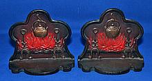 HEARTH FORM BOODENDS   Hearth Form Bookends, cast metal.  Fireplace with fire.  Kettle and andirons.   Colored decoration.  5 3/4'' hieght.  6 1/4'' wide.  2 1/4'' deep.  No Mark. Condition age appropriate wear.