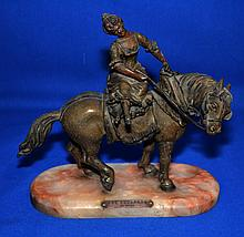 UNE ESCAPADE SPELTAR SCULPTURE ON ROSE ONYX BASE Une Escapade sculpture. Female seated on horse by mesials. Set on a elongated oval rose onyx base. 8 1/4'' hieght. 8 1/4'' long. 3 1/2'' deep. Brass Plaque ''Une Escapade Par Mesiais''. No Mark.