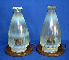 TWO (2) OPALESCENT GLASS SHADES WITH BRASS CHAMBER STICKS Two opalescent glass shades with diamong guilted body. Cones with brass chamberstick bases. Glass: 10'' hieght. 2'' diam. top. 5'' diam.widest part. 4'' diam. base. Chamberstick: 6 3/4'' diam.