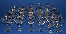 BACCARET CRYSTAL STEMWARE LOT 29 PIECES Plain design with gold top and bottom band. Nine (9) Wine glasses. 5'' hieght. 2 1/2'' diam. top. Nine (9) Water goblets. 6 3/8'' hieght. 3'' diam.top. Eight (8) Saucer champagnes. 4 1/2'' hieght. 3 3/4''