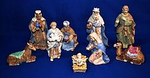ROYAL DOULTON HOLIDAY NATIVITY SET OF NINE (9) PIECES Nine piece Royal Doulton Netivity Set. Includes Christ child in manger, Mary, Joseph, three wisemen, shepherd, donkey and camel. Size ranges 1 3/4'' high to 8''. Mark Royal Doulton Holiday