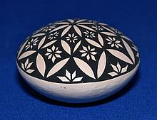 ACOMA  POTTERY VESSEL   Small black and white pottery vessel.  2'' hieght.  3'' diam. widest part.  Signed James Augustine Acoma, N. Mexico  Condition age appropriate wear. Provenance: Desert West Auction Services Lot 1415, March 28, 2010.