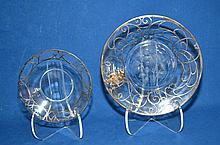 INTAGLIO CUT GLASS SILVER OVERLAY TRAY PLUS 2 PIECES. Lot includes: (1) silver overlay cut glass round tray, center intaglio cut roses on polished bottom, border with scrolling silver overlay sterling and cartouche monogrammed ''F''. Size: 8