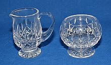 WATERFORD LISMORE PATTERN CREAMER AND SUGAR BOWL. Waterford crystal creamer and sugar bowl in Lismore pattern. Marked; each acid stamped ''Waterford''. Size; footed creamer: 4 1/2''H. footed sugar bowl: 3 1/2''H. Condition: age appropriate wear.