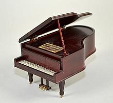 DOLLHOUSE MINI MAHOGANY GRAND PIANO MUSIC BOX Includes, Bench. Works. 3 1/2''x5 3/4''x3 1/4''. Condition, age appropriate wear. All items sold as is.