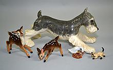 PORCELAIN ANIMAL FIGURINES  Lot includes, a goose, two(2)cats, a terrier, two(2)fawns. Condition, age appropriate wear. All items are sold as is.