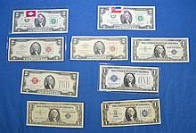 NINE(9) U.S. ONE AND TWO DOLLAR CURRENCY (4)Blue Seal $1 Silver Certificates (3)Red Seal $2 Dollar Notes (2)Green Seal $2 BiCentennial Stamped Bills Condition, age appropriate wear. All items sold as is.
