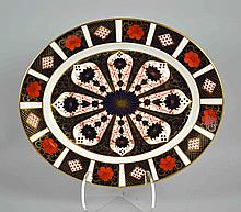 ROYAL CROWN DERBY IMARI OVAL PLATTER #1128 - Measures, 13''x11''. Iron Red, Cobalt Blue, and 22 Carat Gold. Condition, age appropriate wear. All items are sold as is.