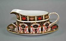 ROYAL CROWN DERBY IMARI GRAVY BOAT AND UNDER PLATE #1128 - Measures, gravy boat 7 3/4''x3 1/2''. Under Plate 8 1/2''x5 1/2''. Iron Red, Cobalt Blue, and 22 Carat Gold. Condition, age appropriate wear. All items are sold as is.