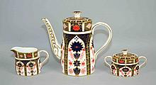 (3) THREE PC ROYAL CROWN DERBY IMARI TEA SET #1128 - Tea Pot, Creamer and Sugar Bowl. Tea Pot measures 10''x9 1/2''x4''. Iron Red, Cobalt Blue, and 22 Carat Gold. Condition, age appropriate wear. All items are sold as is.