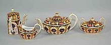 (4) FOUR PC ROYAL CROWN DERBY TEA SET - IMARI #1128  Coffee, Tea Pot, with cream and sugar bowl. Iron Red, Cobalt Blue and 22 Carat Gold. Measures, 9''x4''x4.5''. Condition, age appropriate wear. All items are sold as is.