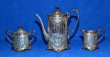 3pc VINTAGE WILCOX HAND CHASED SILVER PLATE WYNWOOD TEA SET - includes teapot (10''H x 10''W x 4.5''D), sugar and creamer - Condition: Teapot has a small dent with a small scratch; Age appropriate wear; All items sold as is.