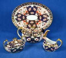 4pc ROYAL CROWN DERBY TEA SET - includes oval platter (12.25''W x 9.5''D), Teapot with lid (4.5''H) (Spout has some flea bites), sugar with lid and creamer (has small chips in the upper edge) - Condition: See conditions above; Age appropriate wear; All items sold as is.