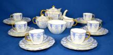 24pc ROYAL CROWN DERBY PORCELAIN TEA SET ORCHID PATTERN - includes Teapot, cream & sugar, waste bowl, (6) cups and saucers, (6) bread and butter plates and (2) serving plates - Condition: Spout on teapot is chipped; Age appropriate wear; All items sold as is.