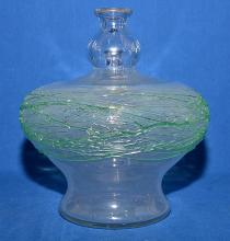 STEUBEN COLORLESS GLASS/CRYSTAL BOTTLE VASE - Controlled buble design with applied green thread design; 11''H, 10'' diameter at widest, 6'' base -  Condition: Interior has a hazy film; Age appropriate wear; All items sold as is.