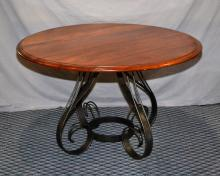 MILLING ROAD 48'' ROUND BREAKFAST TABLE - Solid maple top and a sculptured curly iron base; Made in Italy; Division of Baker Furniture; Measures: 29''H x 48'' diameter - Condition: Age appropriate Wear; All items sold as is.