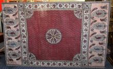 LARGE MALASIAN BATIK WALL HANGING - Paisly border with a center medallion on a burgandy ground; Measures 67'' x 104'' - Condition: Age appropriate Wear; All items sold as is.