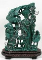 MALACHITE QUANYIN AND ATTENDANT. Chinese pierce carved malachite group with Quanyin, attendant and bird. Comes with fitted wooden base with inlaid wire decoration. No mark. Size: 9 1/4''H, 7''W, 2''D, 10 3/4''H on stand. Condition: age appropriate
