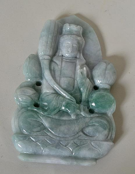 CHINESE CARVED JADE QUANYIN. Carved mottled green/grey jade plaque of seated quanyin on lotus throne. No mark. Size: 5 1/4''H, 3 1/2''W, 1/2''deep. Condition: age appropriate wear.