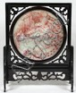 CHINESE JADE AND WOOD TABLE SCREEN. (First half 20th c.) Chinese rotating jade and wood table screen, center circular plaque with phoenix in clouds on front, verso with archaic style characters, mounted in rosewood frame on stand, red veining or