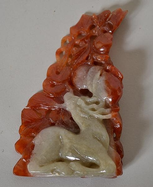 CHINESE CARVED JADE GROUP. red and green jade carving, celadon figure of recumbent antlered deer carved with red jade foliage background. No mark. Size: 3 1/2''H, 2''W, 3/4''Deep. deepest part. Condition: age appropriate wear.