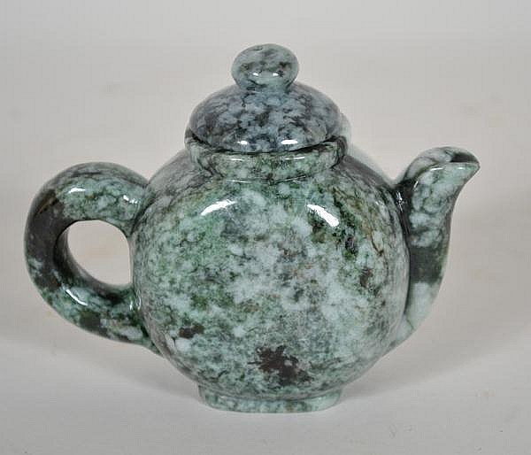 CHINESE CARVED JADE TEAPOT. Mottled green jade teapot, flattened circular form. No mark. Size: 3 3/4''H, 4 1/2''W. 2''deep. Condition: age appropriate wear.