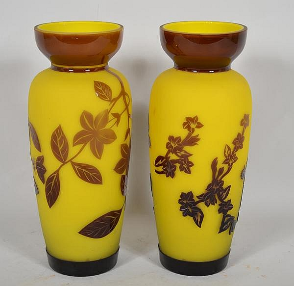 PAIR CHINESE PEKING OVERLAY GLASS VASES. Baluster form vases with waisted neck, cut brown over yellow, thick walls, each with different floral and leaf design, flat polished tops. No mark. Size; 10 3/4''H, 3 3/4''Diam. top, 4 1/2''diam. widest part,