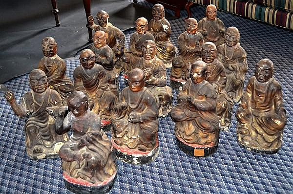 18 CARVED WOODEN LOHANS. 18th - 19th C. group of 18 Lohans (arhats with attributes) carved gessoed lacquered and gilded figures. 18