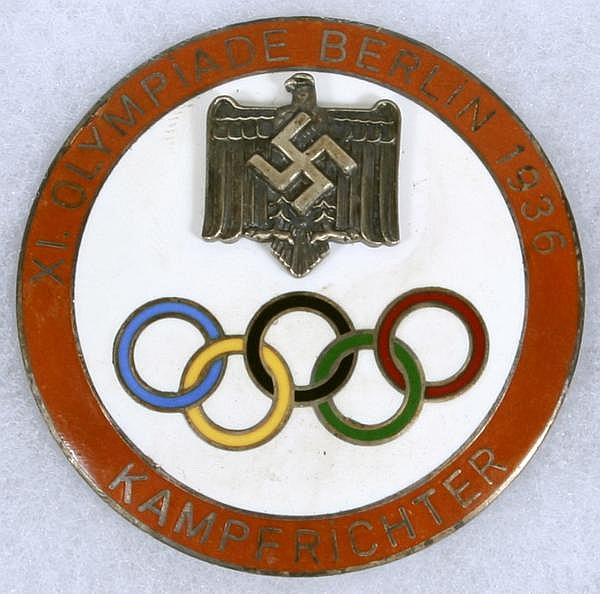 1936 BERLIN OLYMPICS KAMPFRICHTER JUDGES BADGE. 1936 XI Olympiade Berlin Kampfrichter badge. white ground, five color rings, red border, judges badge. Marked: Ges. Gesch. BC. Size: 2''Diam. Condition: age appropriate wear.  270-180.