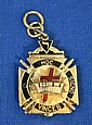 14K GOLD AND ENAMEL MASONIC WATCH FOB. Hinged sections with enameling in black, white, blue and red. Engraved and dated 1920. Condition: excellent. Dimensions: 1 3/16'' X 7/8''. Weight: 12.3 dwt.