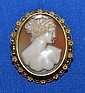 14K YELLOW GOLD CARVED CAMEO PIN. Oval carved bust of a neoclassical woman, set in a 14K yellow gold filigree bezel. Safety clasp and pendant loop. Marked: K14. Dimensions: 1 1/2'' X 1 1/8''. Weight: 4.4 dwt.