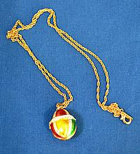 FABERGE STYLE ENAMELED EGG PENDANT NECKLACE  Enamel and Rhinestone Egg on a Gold Tone Chain. Chain 23''L. Pendant 1''L.  No Mark. All jewelry sold as is. (L#270)