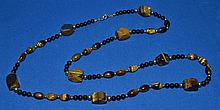 TIGER EYE AND ONYX NECKLACE  Tiger eye, Onyx and gold bead necklace. 34''L. No Mark. Condition all jewelry sold as is. (L#264)