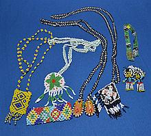 INDIAN BEAD WORK JEWELRY LOT 7 PIECES  Includes, 4 necklace. 2 bracelet. 1 pair of earrings.  No Mark. Condition all jewelry sold as is. (L#310)