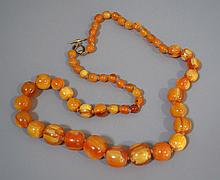VARIEGATED BUTTERSCOTCH AMBER NECKLACE  Graduated Amber Bead, Hand Knotted Necklace. With Variegated Butterscotch Color.  30''L. No Mark.  Condition age appropriate wear. All jewelry sold as is.