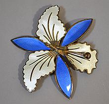 NORWEGIAN STERLING AND ENAMEL ORCHID BROOCH  Orchid brooch with enamel on sterling. 2 3/4''H. 3''W. Mark, Norway Sterling 925. Condition, age appropriate wear. All jewelry sold as is.