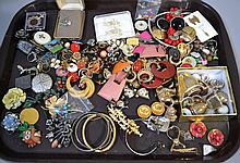 COSTUME JEWELRY LOT 50+ PIECES  Lot includes, 4 rings, 12 brooches, 4 bracelets, 20+ earring sets and other. No Mark. All jewelry sold as is.