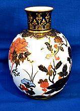 CROWN DERBY PORCELAIN VASE  Crown Derby Molded Porcelain Vase.  Imari colors with floral scene. Cobalt and gilt neck. Base rim.  9 1/2''H.  3''diam.top.  7''diam.widest part.  Mark, Crown Derby Porcelain. Condition, age appropriate wear.